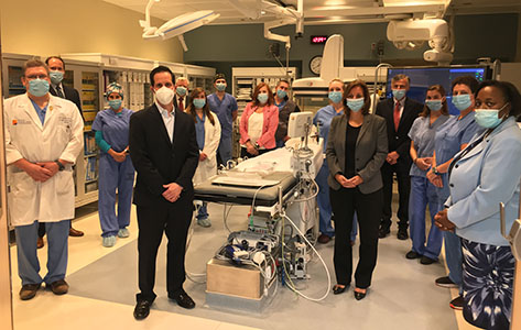 Hospital leadership along with cardiac cath lab physicians and team members celebrate the launch of its new PCI program at Newton Medical Center.