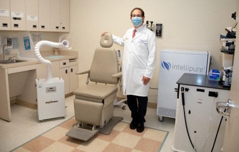 Erik Cohen, MD, shows additional safety tools in place in a treatment room.