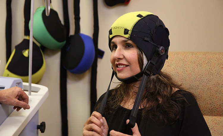 Woman wearing scalp cooling therapy cap