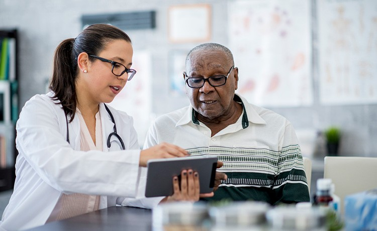 Doctor reviews cancer resources with patient