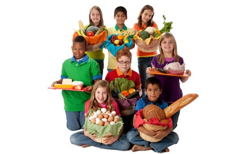 Group of children holding healthy food.