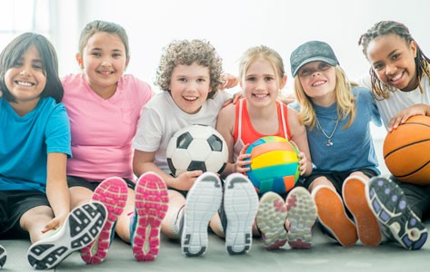 Athletic children getting ready for sports