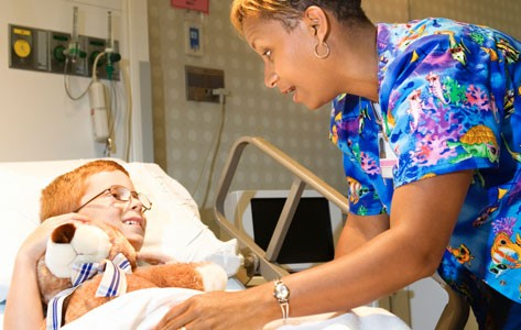 Nurse provides palliative care to sick boy