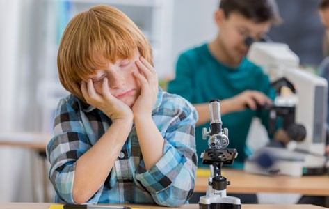 Boy falls asleep in school lab