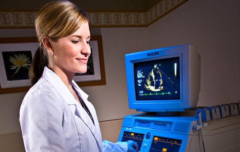 Cardiac imaging professional performing echocardiogram