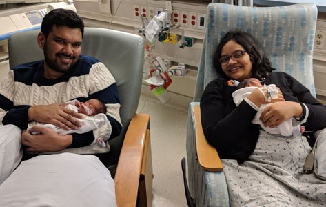 Parents hold premature twins in Overlook Maternity Center