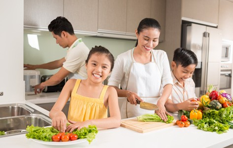 Family cooking a healthy meal together