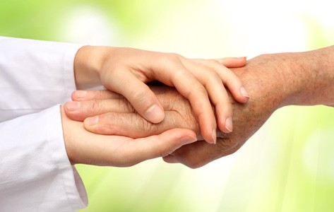 Provider holding patient's hand for support