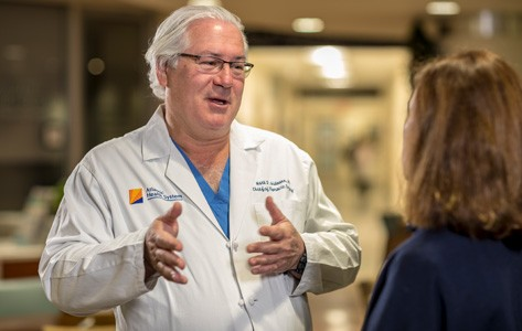 Lung cancer surgeon talks to patient