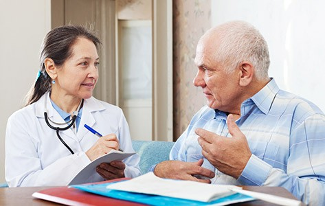 Doctor discusses cancer rehab with patient