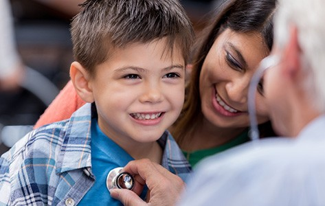Advanced Urgent Care physician examines young boy