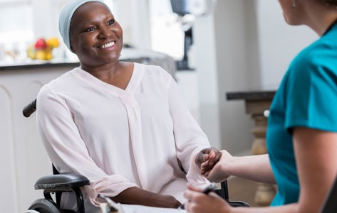 Hospice nurse visits patient in wheelchair