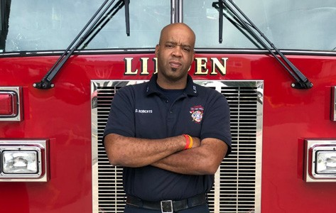Firefighter Daryl Roberts at his firehouse after receiving wound care from Atlantic Health.