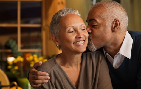 African American man kissing woman