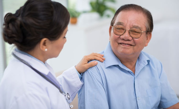 Doctor consoles cancer patient