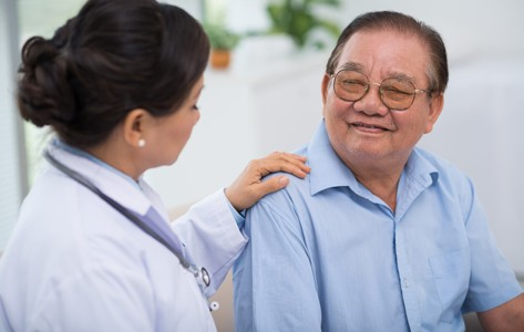 doctor talking to patient about health