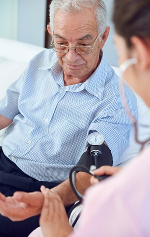 man getting blood pressure