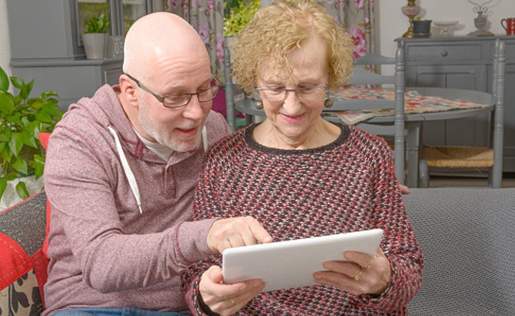 Couple manage health on tablet