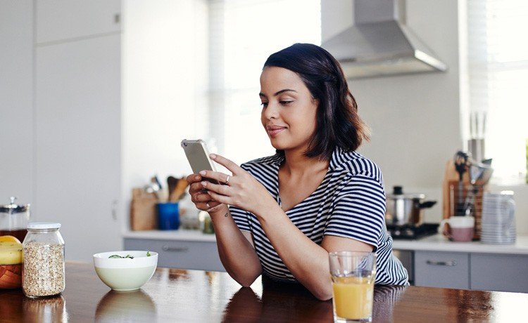 Woman uses Atlantic Anywhere app on phone