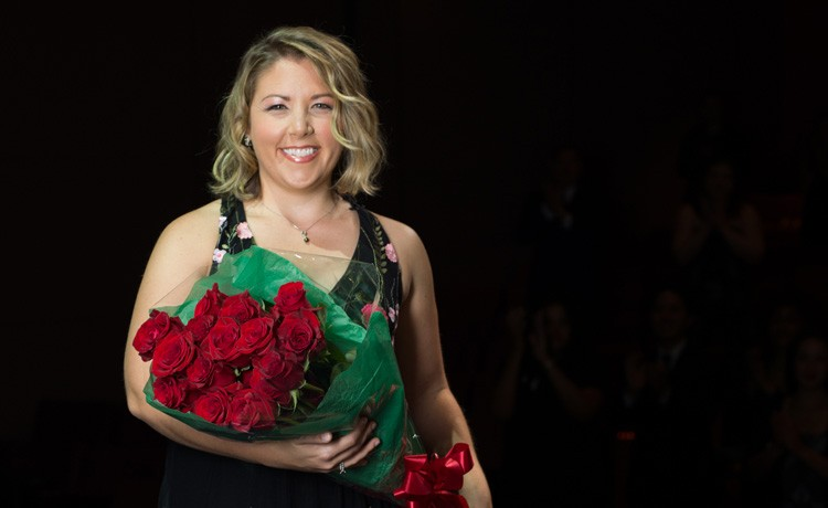 Megan receives flowers at concert
