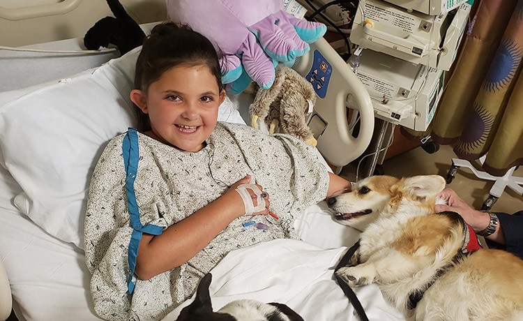 Goryeb brain tumor patient with pet therapy dog